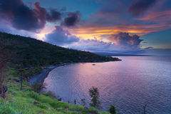 Sunset in Amed bay. Sunset with amazing colourful sky and clouds in bay in Amed, Bali, Indonesia Stock Photos