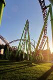 Sunset in the amusement park. Roller coaster. stock photography