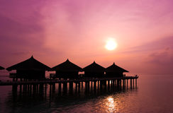 Sunset And Water Bungalows Stock Photo