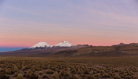 Sunset in Andes. Parinacota and Pomerade volcanos. Royalty Free Stock Photos