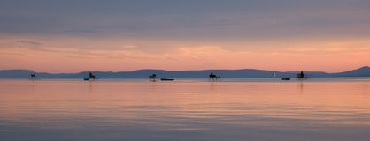 Sunset anglers Stock Photo