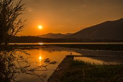 Sunset at annone lake lecco italy alps mountains. Water stock photo