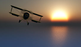 sunset and an antique propeller airplane Royalty Free Stock Photos