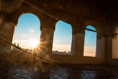 Sunset from Arabian windows. Arc shaped windows. And engraved on the wall Royalty Free Stock Photos