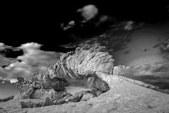 Sunset Arch near Escalante in black and white, Utah, USA. Natural arch in black and white in the Escalante desert, Utah,  USA Royalty Free Stock Photography
