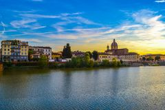 Sunset in Arno river with San Frediano in Cestello Church of Sa royalty free stock image