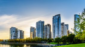 Sunset as the sun is setting behind modern Skyscapers lining the skyline of Yaletown. Along False Creek Inlet of Vancouver, British Columbia, Canada royalty free stock photos