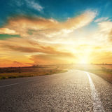 Sunset and asphalt road Royalty Free Stock Photos