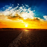 Sunset and asphalt road to horizon Royalty Free Stock Photography