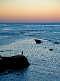 Sunset in Assilah. A person watching a beautiful sunset from Asillah Stock Images