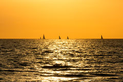 Sunset on Atlantic ocean with the boats on the horizon. Sunset on Atlantic ocean with the yachts on the horizon Royalty Free Stock Image