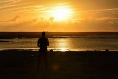Sunset on the Atlantic ocean coast. Man looking at the sunset on the Atlantic ocean coast Royalty Free Stock Photo