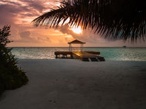Sunset on an atoll, Maldives. Small jetty on an atoll in Maldives Stock Image