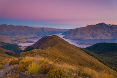 Sunset atop the Ben Lomond Track in South Island, New Zealand. Watching the sky turn shades of pink above Queenstown atop the Ben Lomond Track Stock Image