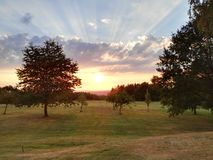 Sunset in August. Beautyful sunset at golfcourse royalty free stock image