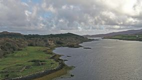 Sunset in autumn at Dunvegan Castle, Isle of Skye. Aerial stock video
