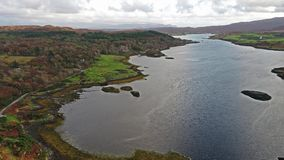 Sunset in autumn at Dunvegan Castle, Isle of Skye. Aerial stock video footage