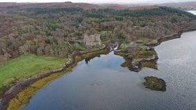 Sunset in autumn at Dunvegan Castle, Isle of Skye. Aerial stock footage