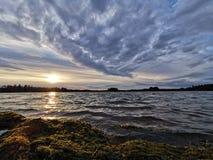 Sunset with awesome clouds. Cloudy, lake, lakes, finnishlake, sunsets, beautyful, sunlight, finland, waves, windy, beautifulnature, water, beach, swimming royalty free stock image