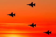 On sunset background. Armed fighter jets on the red sunset background Stock Photos