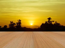 Sunset background and  brown wood paving. Nature background for design Royalty Free Stock Image