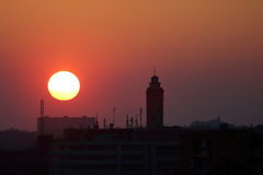 Sunset on a background of city buildings Stock Images