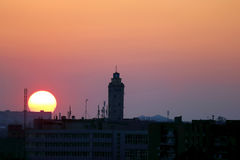 Sunset on a background of city buildings Stock Photo