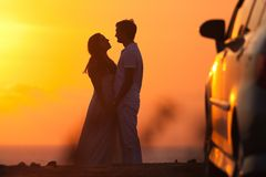 Sunset background of silhouette couple Stock Photos