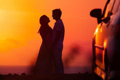 Sunset background of silhouette couple Royalty Free Stock Photography