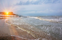 Sunset on the background of a stormy sea Royalty Free Stock Photo