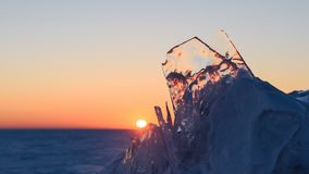 Sunset on the background of ice floes. Sunset on the background of transparent ice in the frozen sea stock video footage