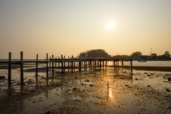 Sunset background and wooden bridge Stock Image