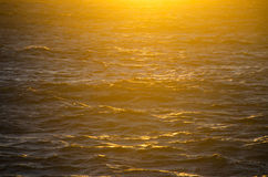 Sunset. With backlight by the sea royalty free stock photo