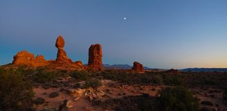 Sunset at Balanced Rock in Arches National Park stock photos