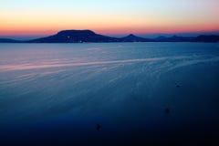 Sunset by Balaton lake 2. View to wine region Badacsony in Hungary royalty free stock images