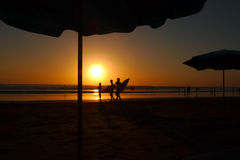 Sunset at Bali. Surfers in the Kuta Beach sunset, Bali royalty free stock photo