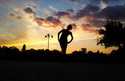 Sunset ballerina. Girl posing as a ballerina. Picture taken on sunset Stock Photography