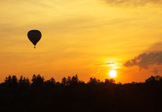 Sunset and balloon Stock Photography