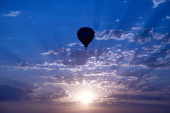 Sunset balloon. A hot air balloon is silhouetted at sunset royalty free stock photo