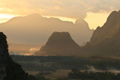 Sunset during Balloon flight in Vangvieng. Balloon over Song river in Vangvieng, Vang Vieng is a tourist attraction town in northern Laos Stock Images