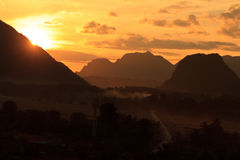 Sunset during Balloon flight in Vangvieng. Balloon over Song river in Vangvieng, Vang Vieng is a tourist attraction town in northern Laos Royalty Free Stock Image