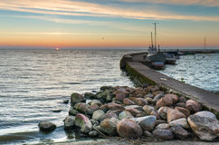 Sunset at the Baltic bay in Nida. Yachts and motorboats docked at harbor in Nida village, Curonian spit, Lithuania Royalty Free Stock Photography