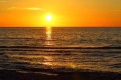 Sunset at the baltic sea beach of ustronie morskie, poland. Sunset at the baltic sea beach of ustronie morskie in poland royalty free stock image
