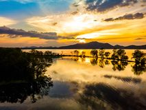 Sunset at Bang Pra reservoir. Beautiful aerial nature view of sunset over Bang Pra reservoir, Chonburi province, Thailand royalty free stock photography