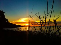 Sunset at Bangkah Beach Royalty Free Stock Photo