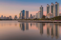 Sunset at Bangkok city downtown with reflection of skyline Royalty Free Stock Image