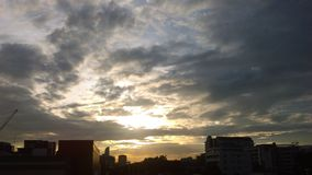 Sunset. In Bangkok with clouds floating Royalty Free Stock Photos