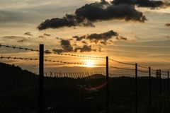 Sunset and barbwire Stock Image