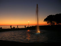 Sunset in Barcola. Trieste: looking at the water play fountain Barcola at sunset Stock Photos