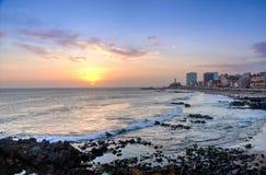Sunset at Barra Beach with Farol da Barra Barra Lightouse on Background - Salvador, Bahia, Brazil. Sunset at Barra Beach with Farol da Barra Barra Lightouse on stock image